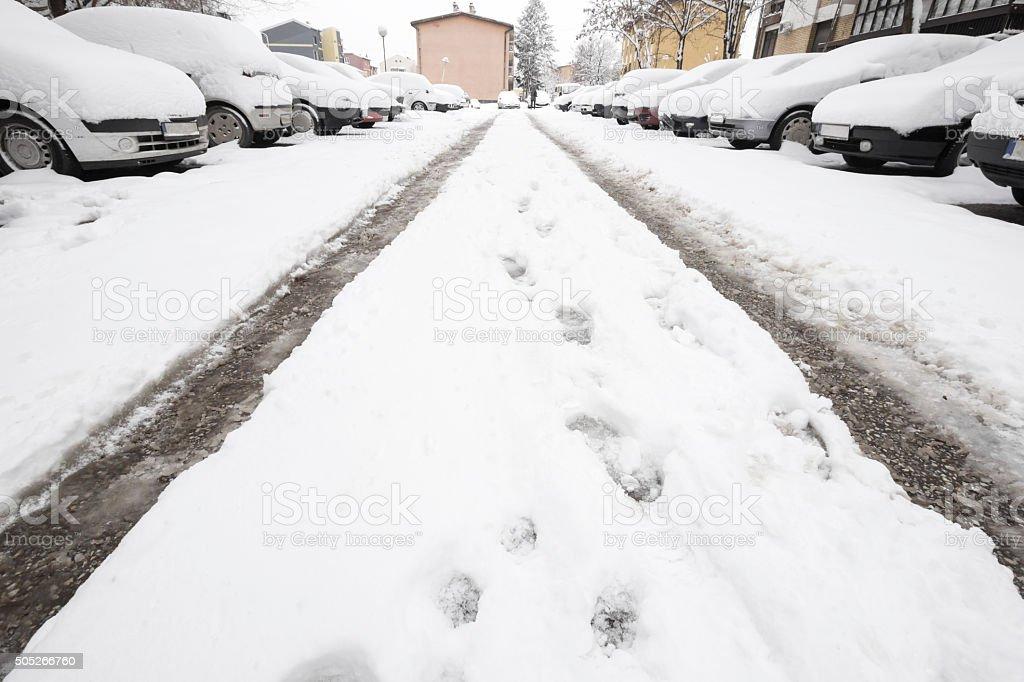 Snowed cars on parking lot stock photo