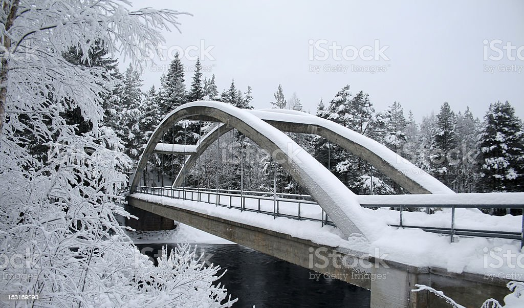Snowed over bridge stock photo