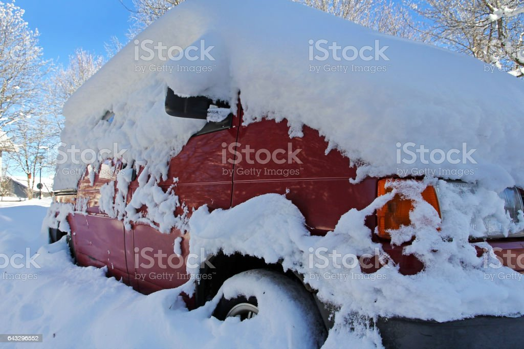 Snowed red car in winter stock photo