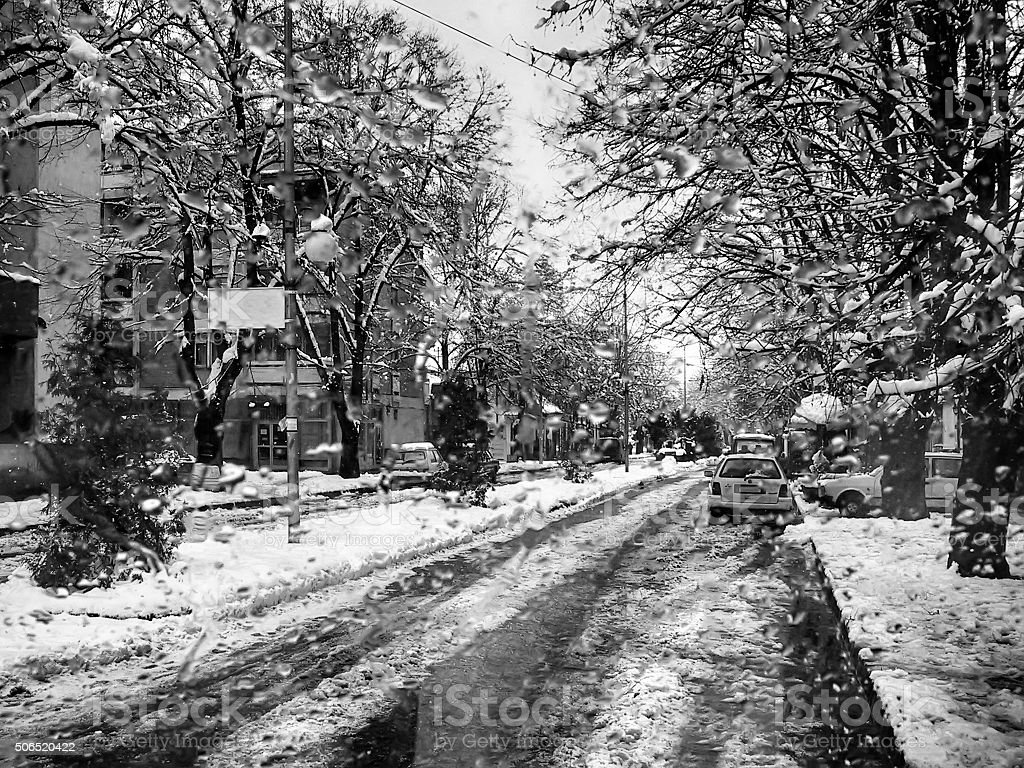 Snowed streets in the city stock photo