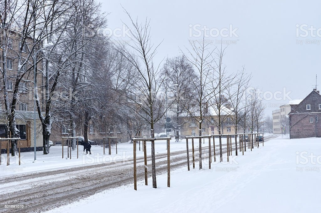 Snowfall in the city streets stock photo