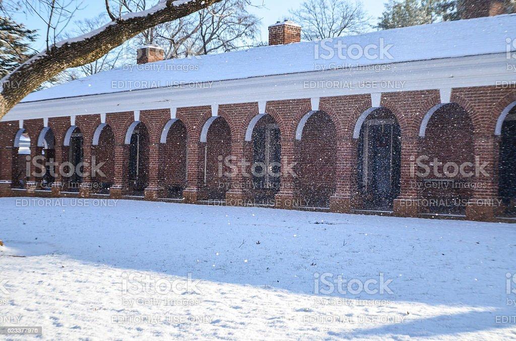 Snowfall on lawn of University of Virginia dormitories stock photo