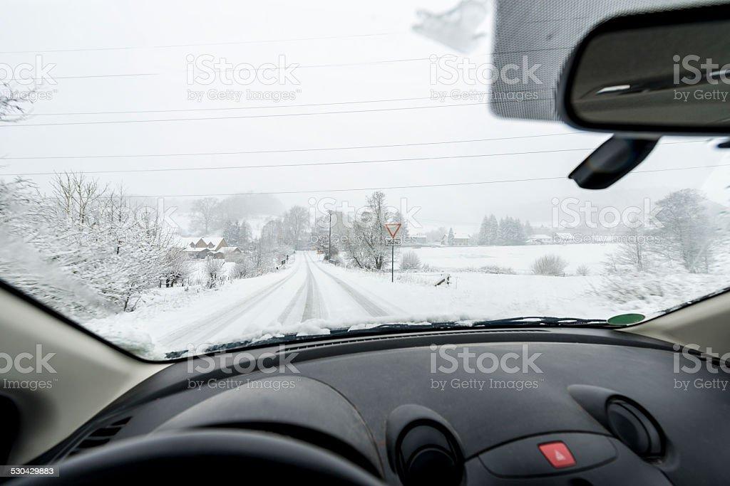 Snowfall,Country Road driving stock photo