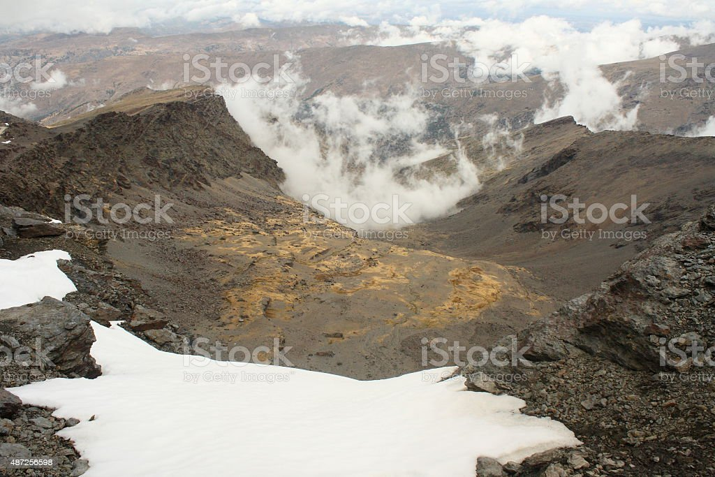snowfield on volcanic slopes stock photo