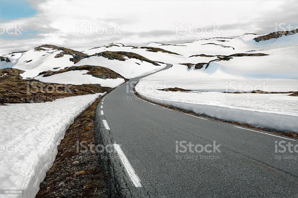 Snowfields Road in Norway stock photo