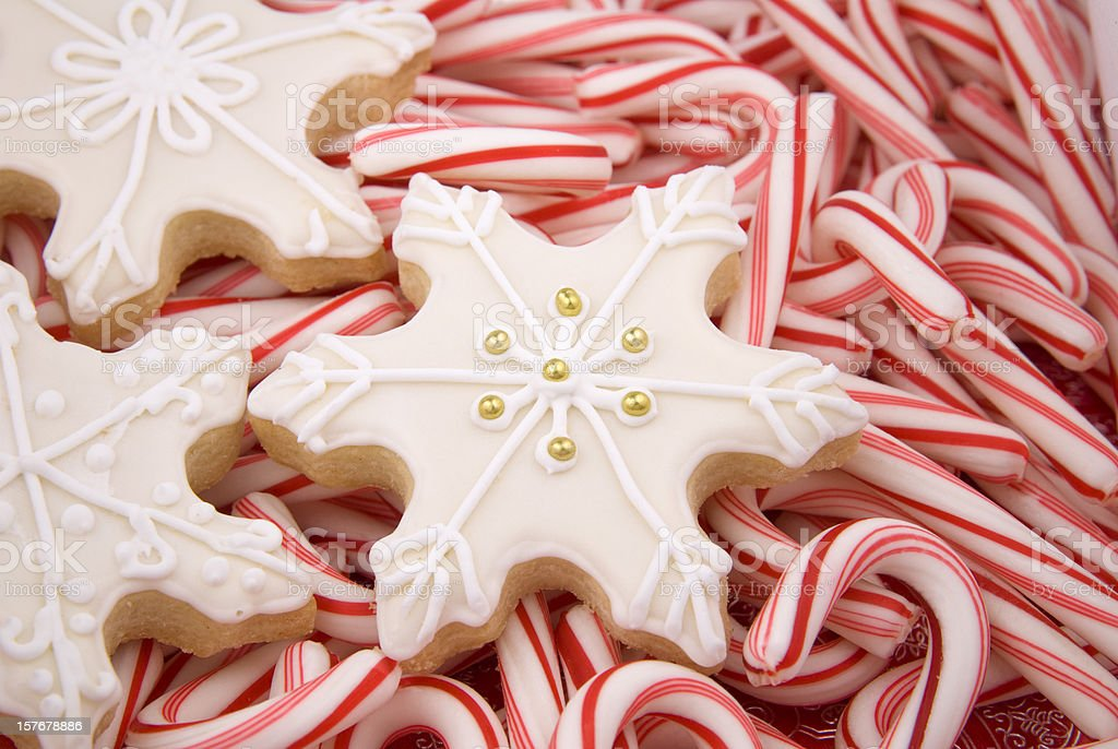 Snowflake Christmas Cookies & Peppermint Candy Cane Holiday Food Background royalty-free stock photo