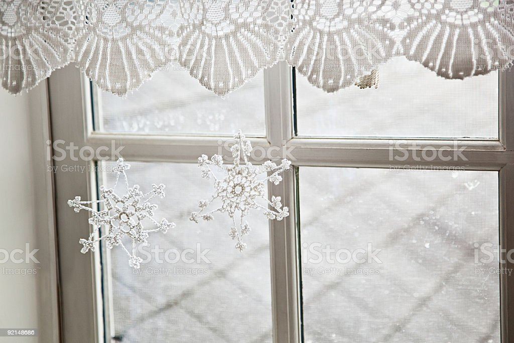 Snowflake decorations in window royalty-free stock photo