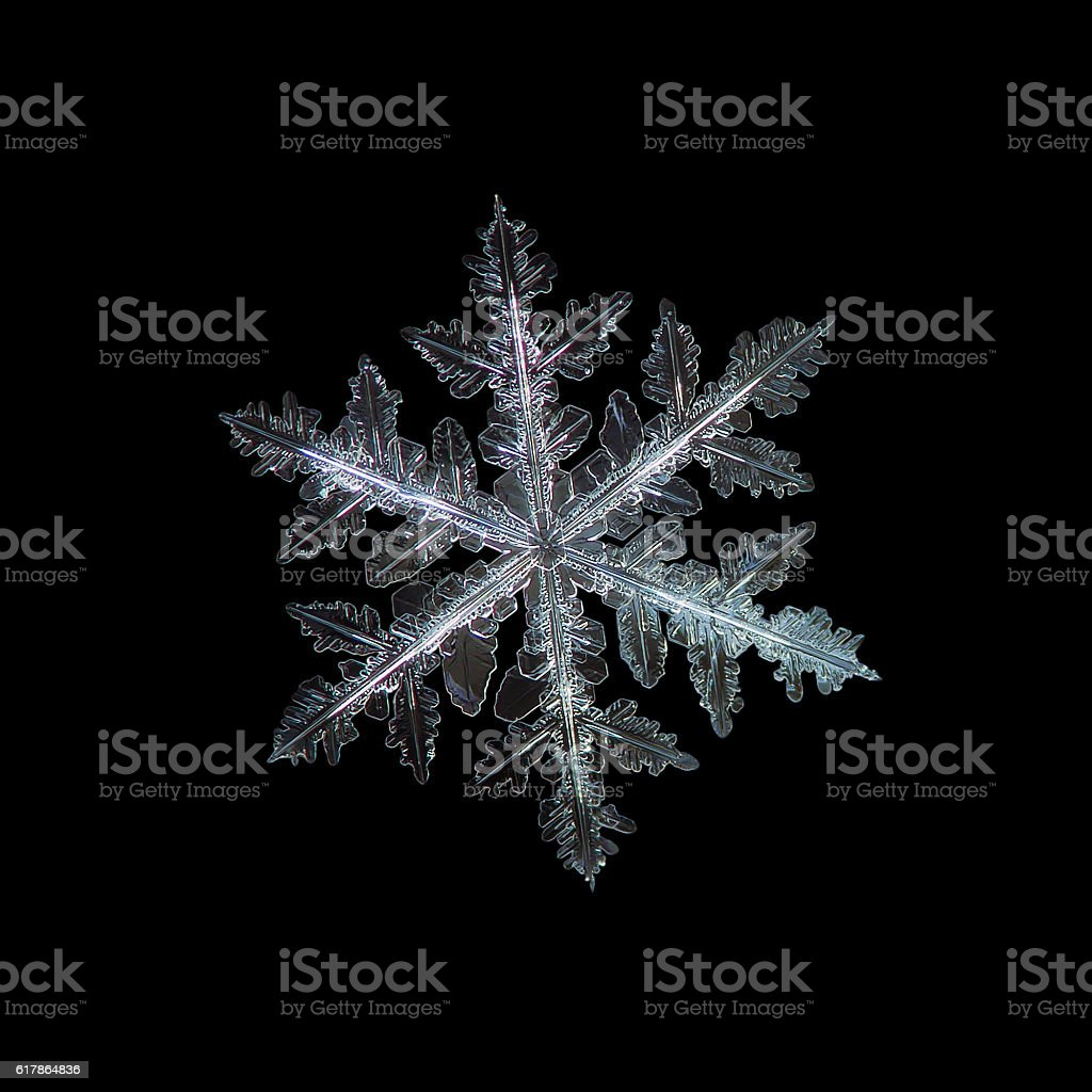 Snowflake isolated on black background stock photo