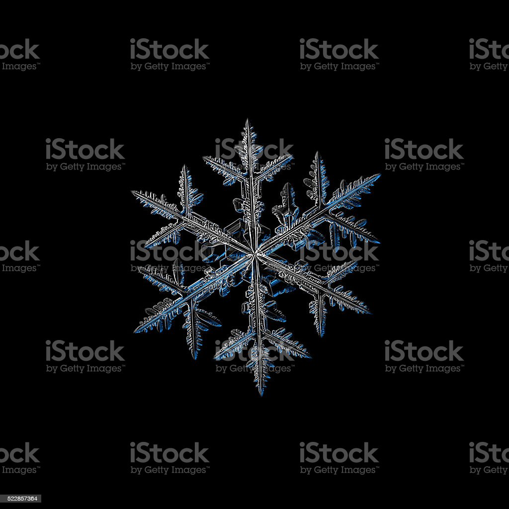 Snowflake isolated on black stock photo