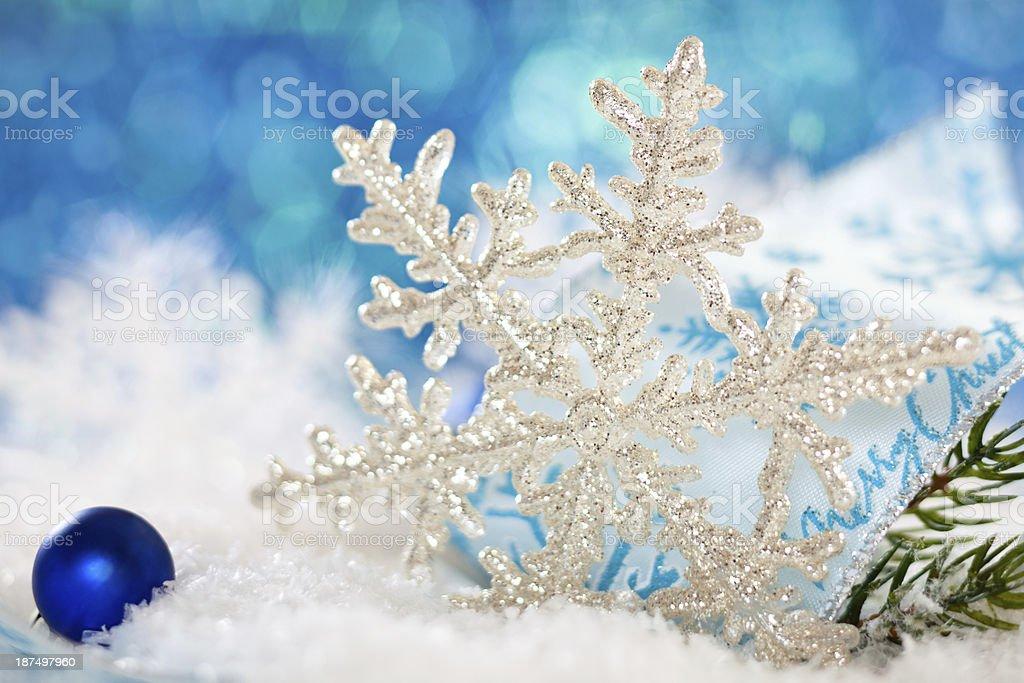 Snowflake on snow. royalty-free stock photo