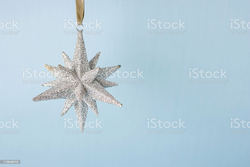 Snowflake ornament on blue royalty-free stock photo
