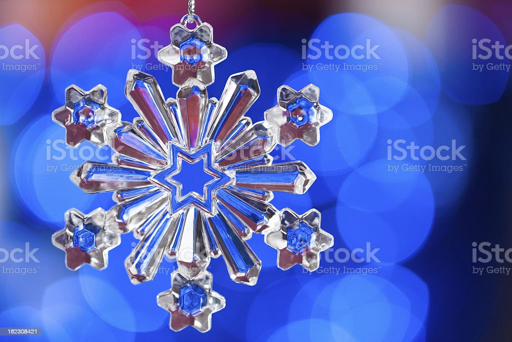 Snowflake over blue background royalty-free stock photo