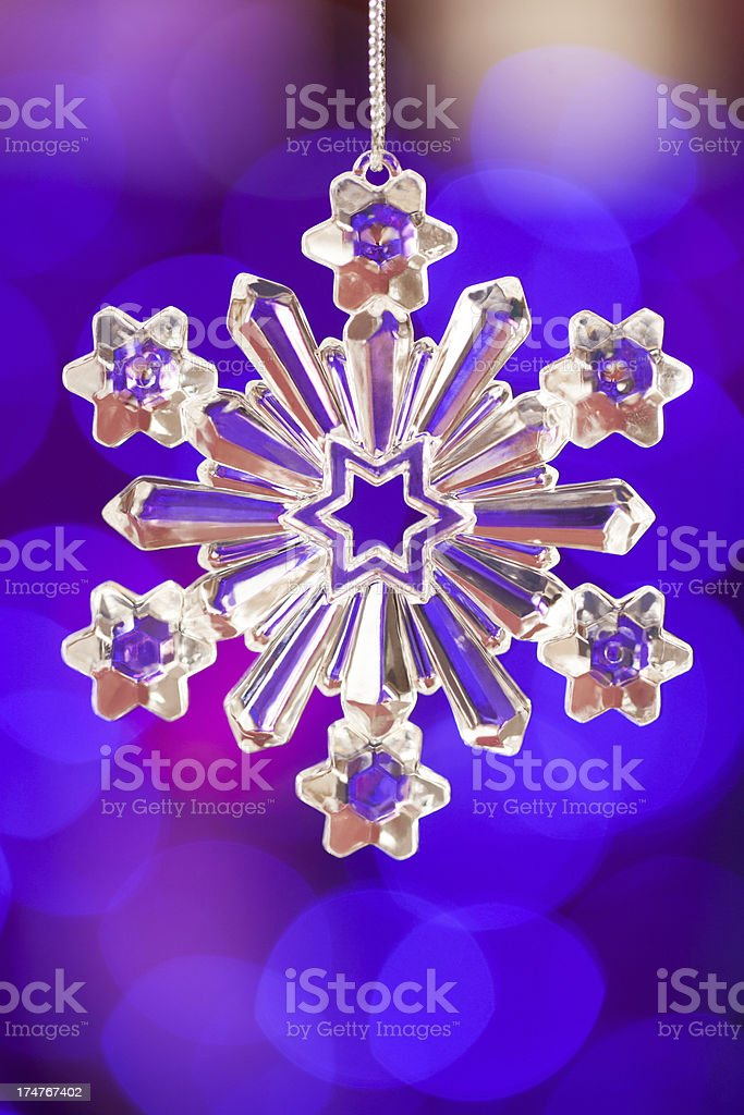 Snowflake over purple background royalty-free stock photo
