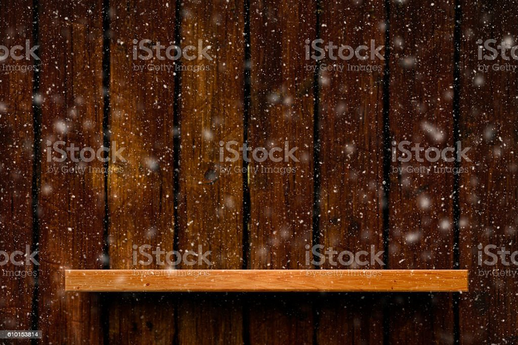 Snowflakes falling background with empty shelf stock photo
