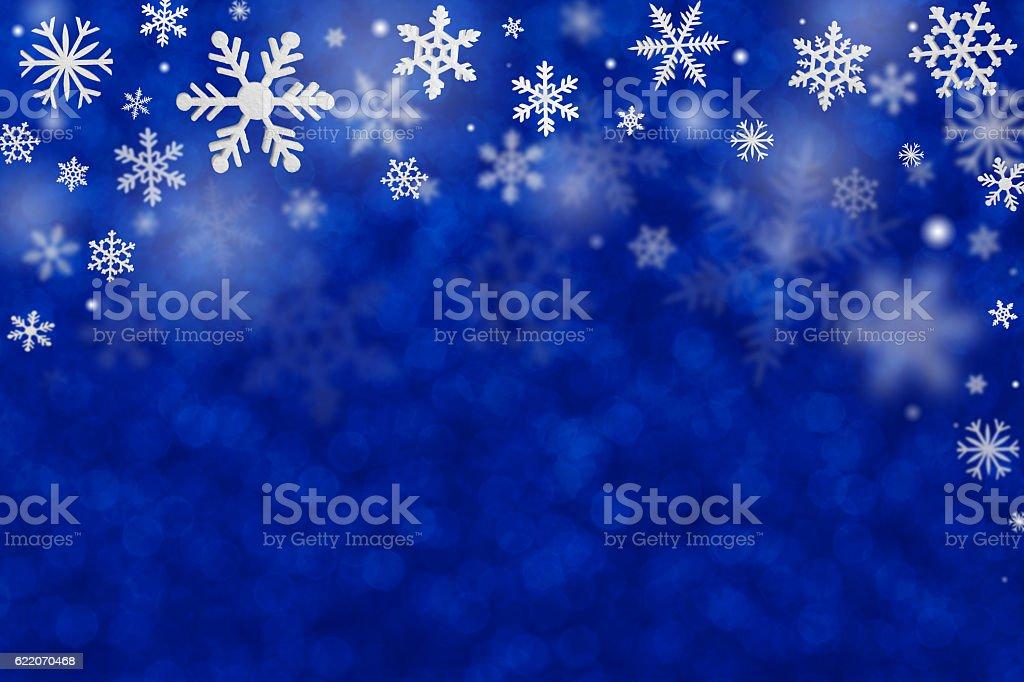 snowflakes top decoration on defocused background stock photo