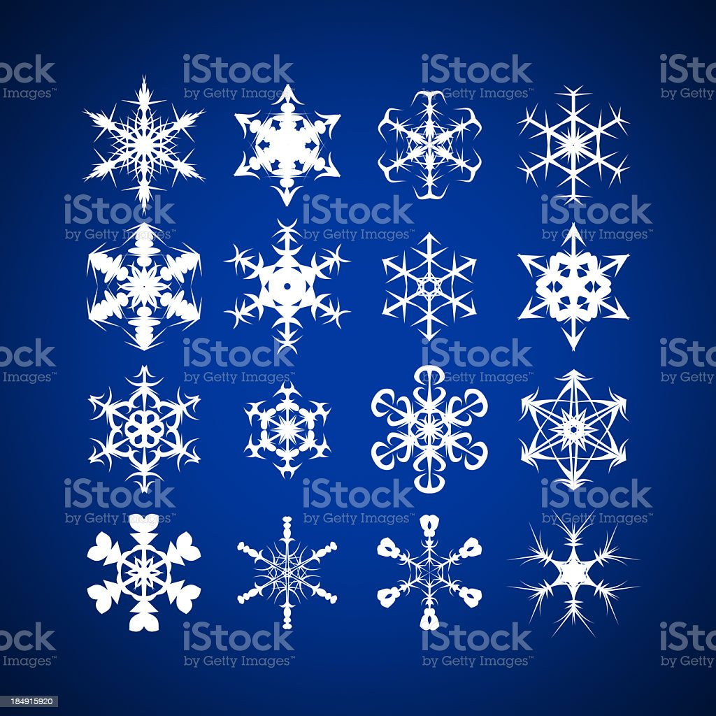 Snowflakes with different shapes against blue background stock photo