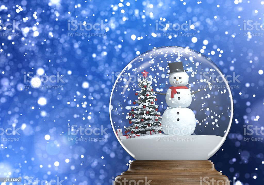 snowglobe with snowman inside and copy space stock photo
