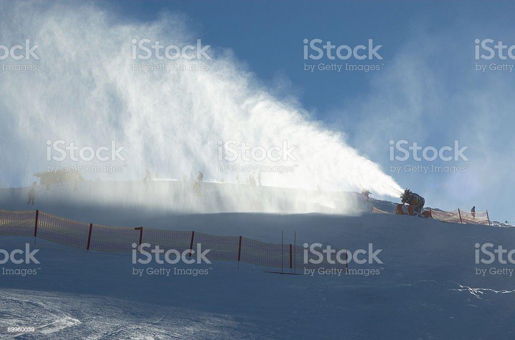 Snowgun with glitter stock photo
