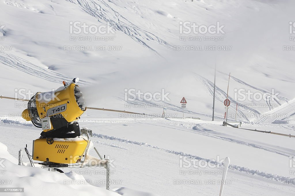 Snowing artificial snow made with snowgun during beautiful day stock photo