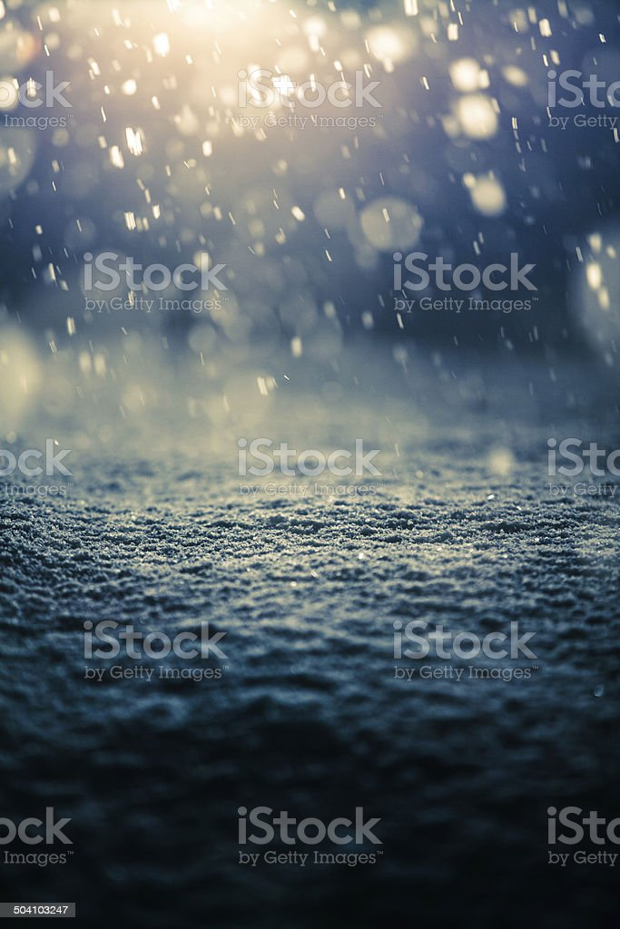 Snowing at Night and Backlight stock photo