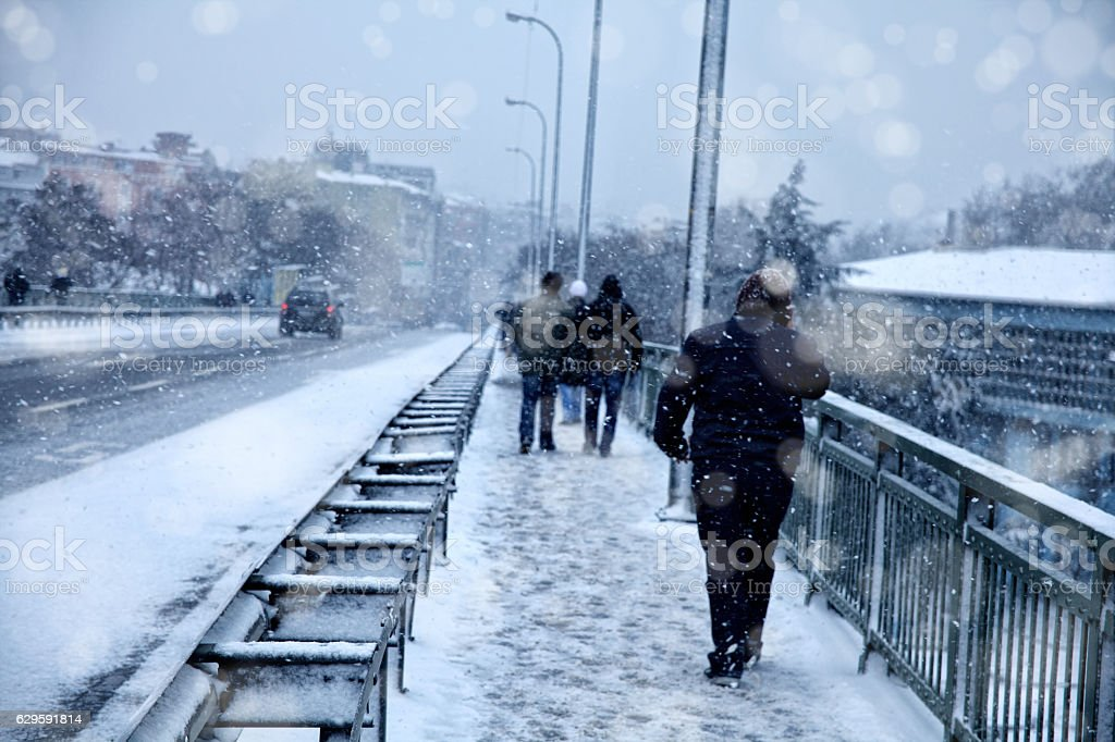 snowing in city stock photo