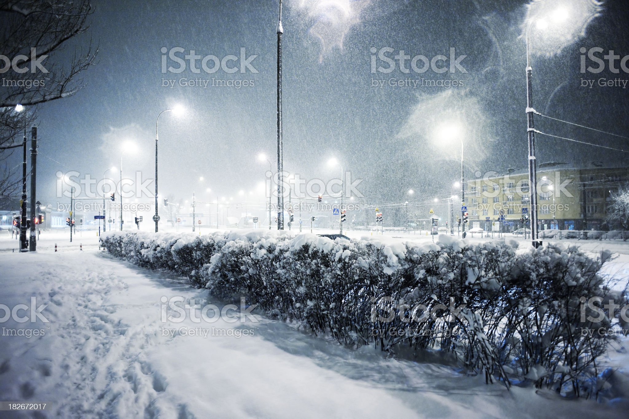 Snowing in the city at night royalty-free stock photo