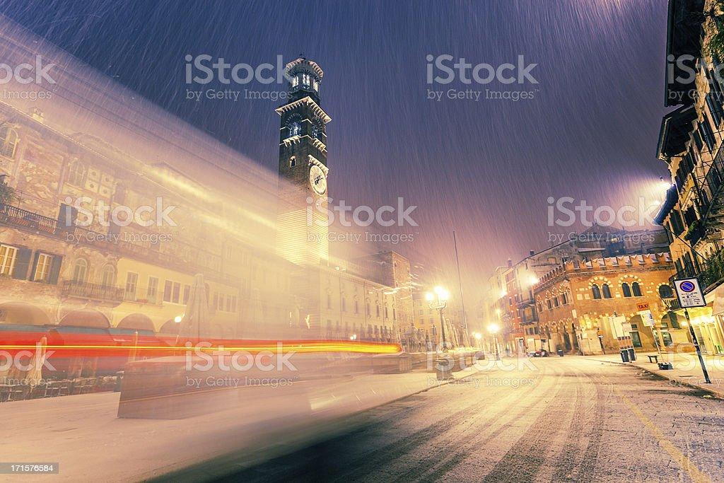 Snowing in Verona at night stock photo