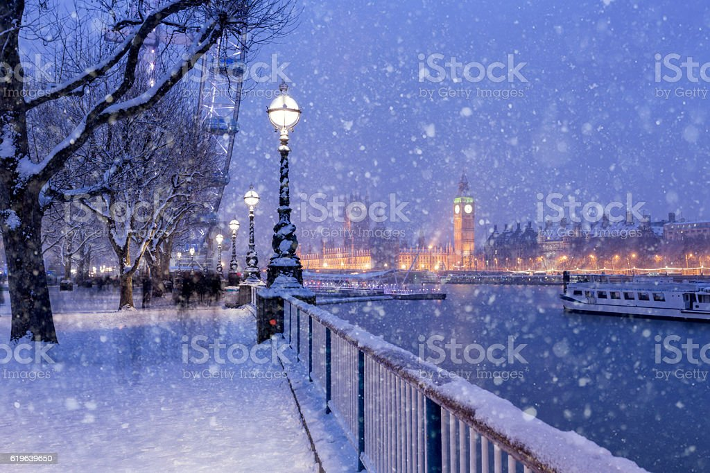 Snowing on Jubilee Gardens in London at dusk stock photo