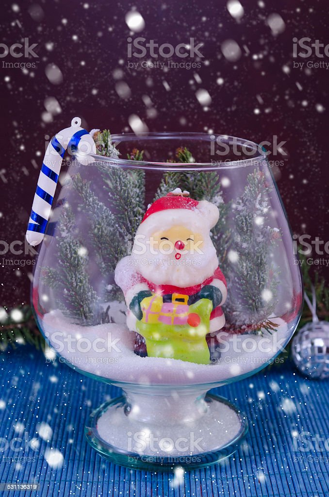 Snowing over Santa in a glass vase, royalty-free stock photo