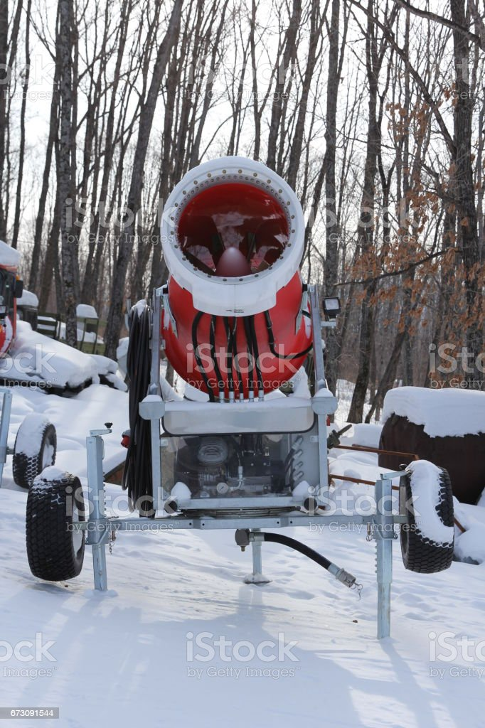 Snowmaking is the production of snow on ski slopes. stock photo