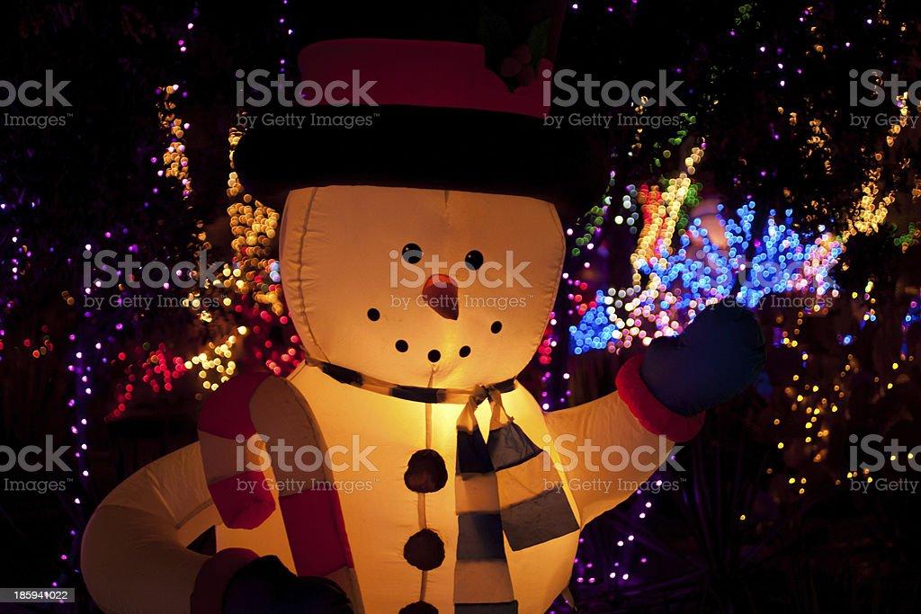 snowman and christmas lights stock photo