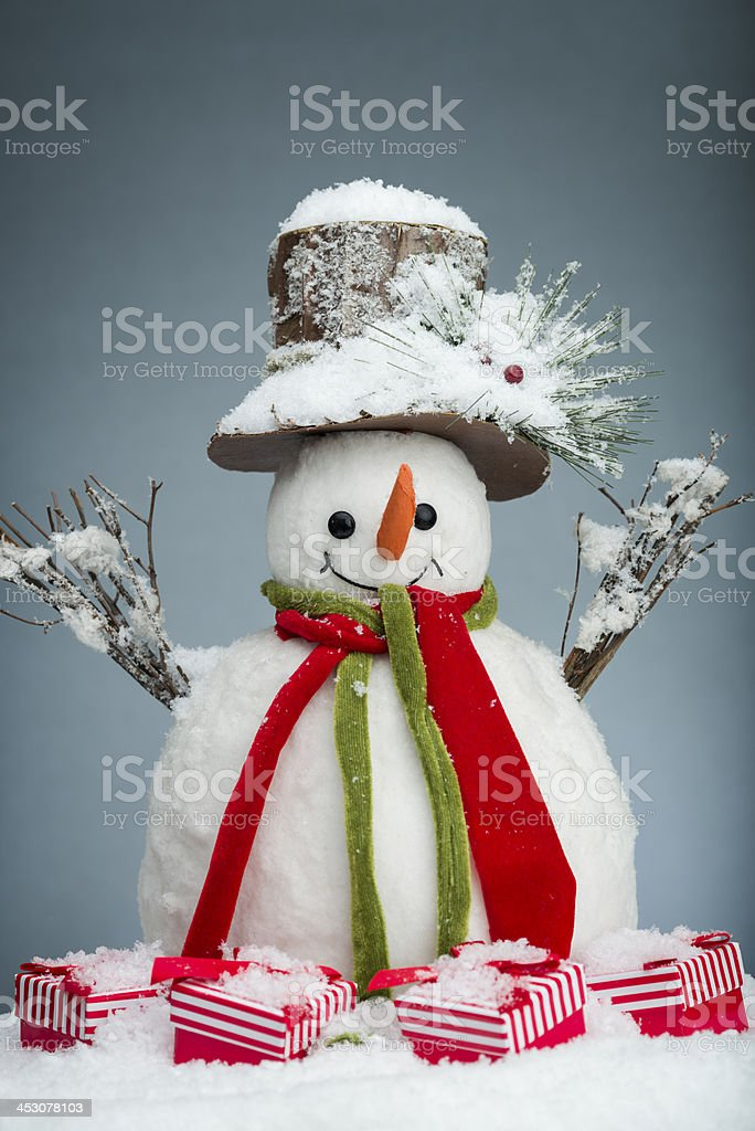 Snowman and Christmas presents royalty-free stock photo