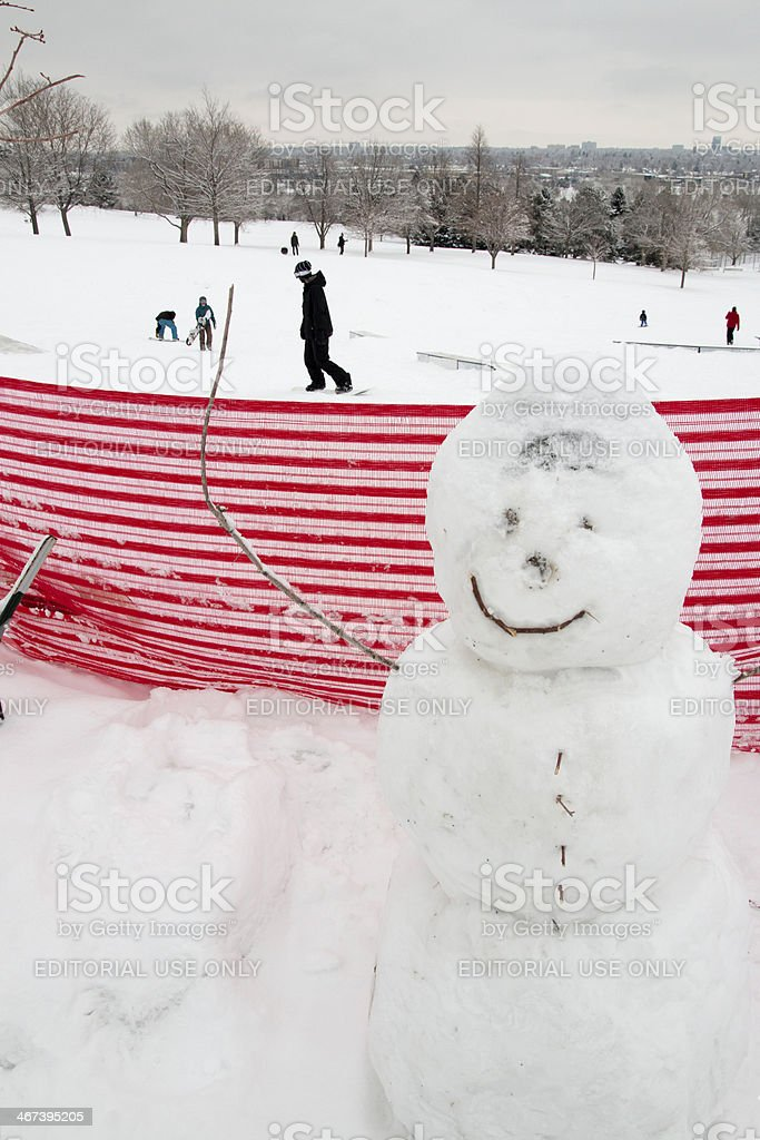 Snowman and snowboarders at rail yard Denver stock photo