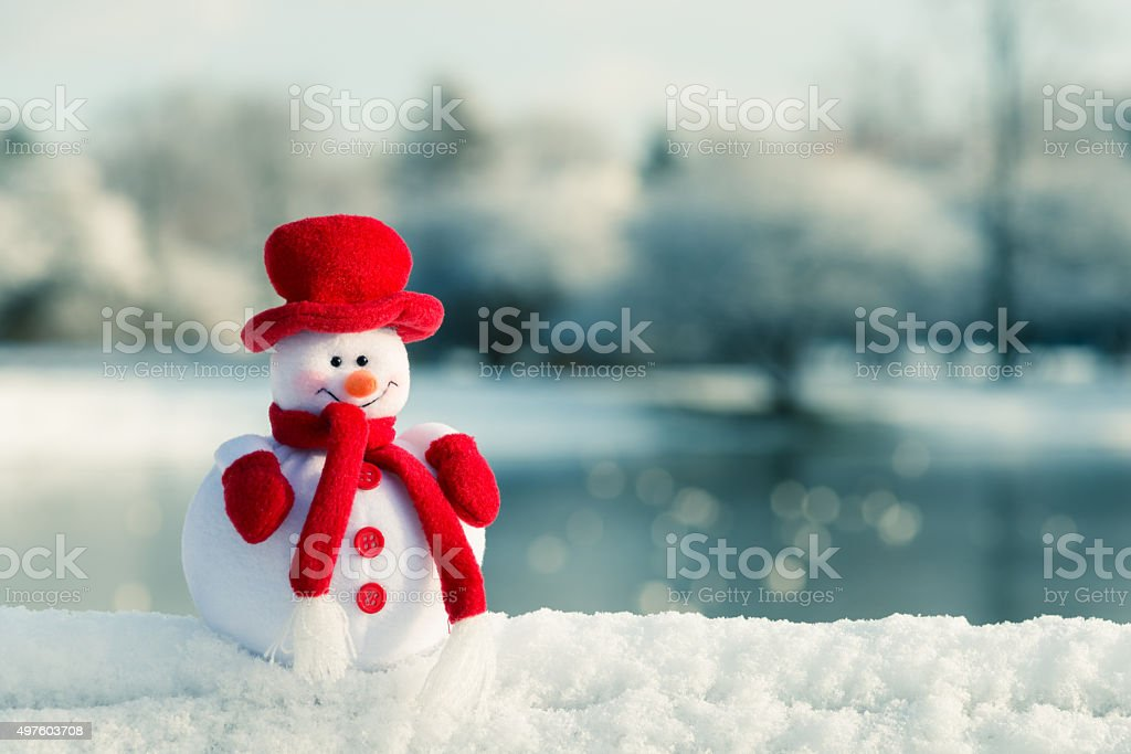 Snowman and winter landscape in the background stock photo