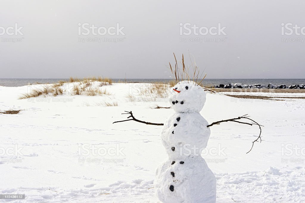Snowman at Beach of Darss (Germany) in winter stock photo