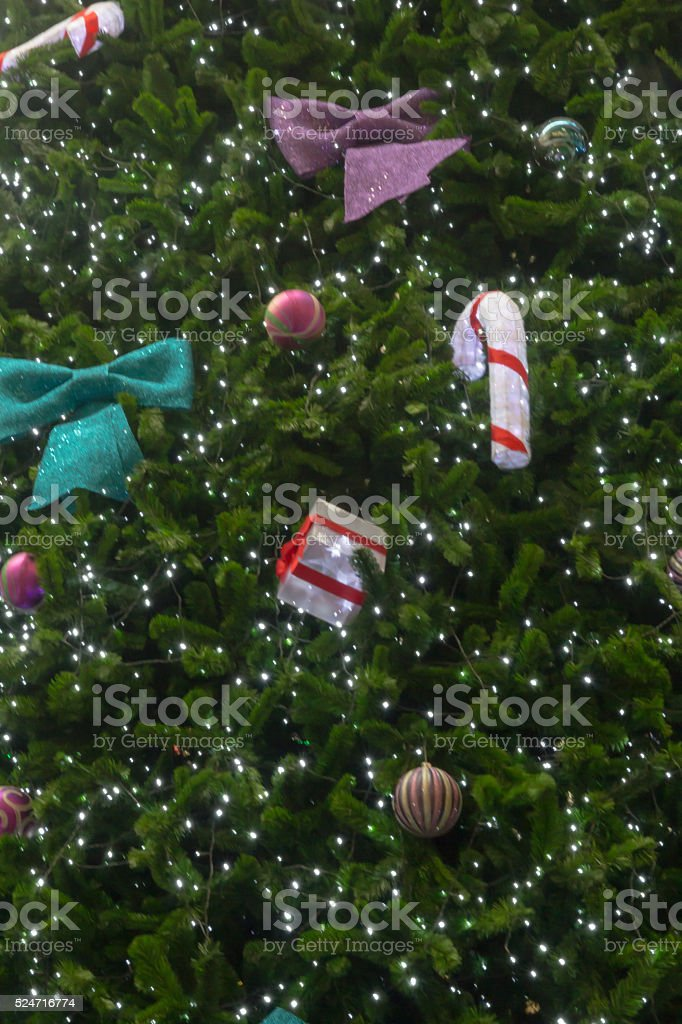 snowman behind christmas tree gifts stock photo