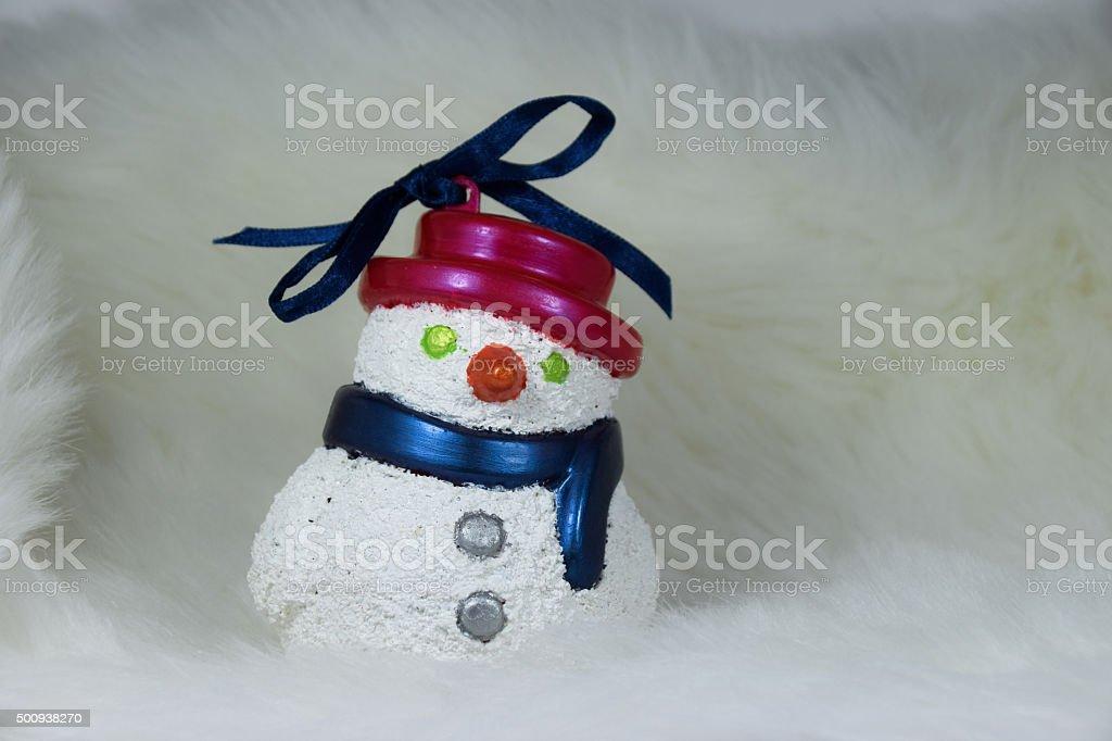 snowman christmas decor on white soft fabric background stock photo