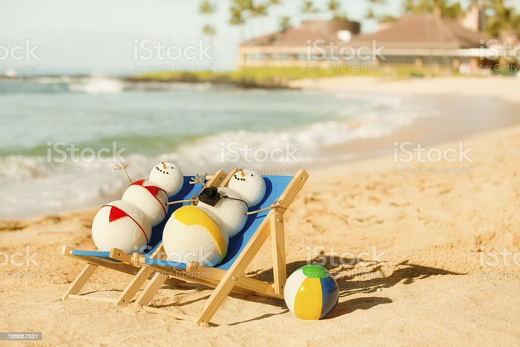Snowman Couple Vacationing in Tropical Paradise beach vacation royalty-free stock photo