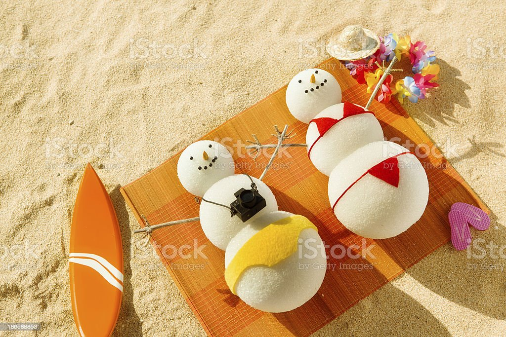 Snowman Couple Winter Vacation in Tropical Beach Resort stock photo