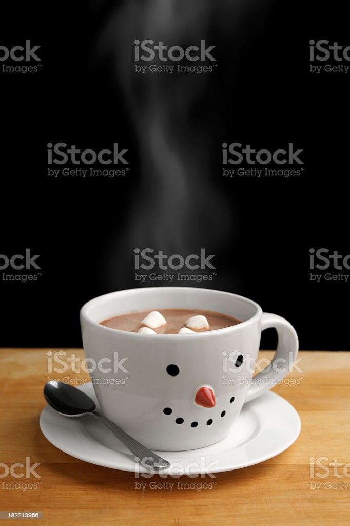 Snowman cup full of hot chocolate with marshmallows royalty-free stock photo