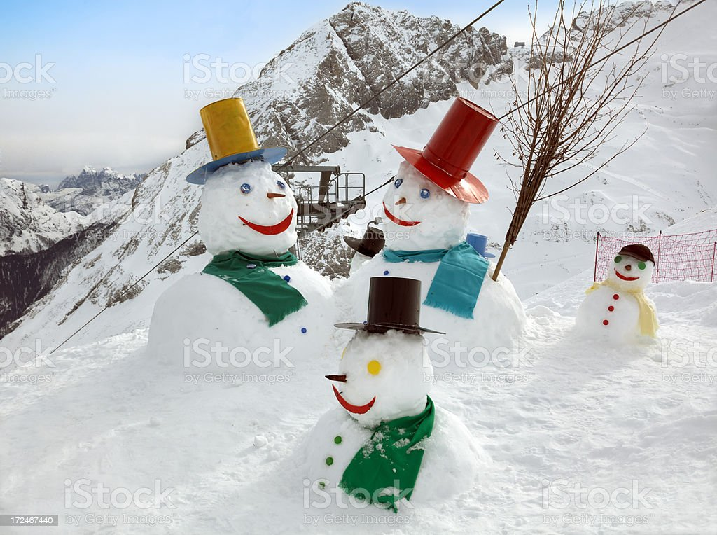 Snowman Family in the mountains royalty-free stock photo