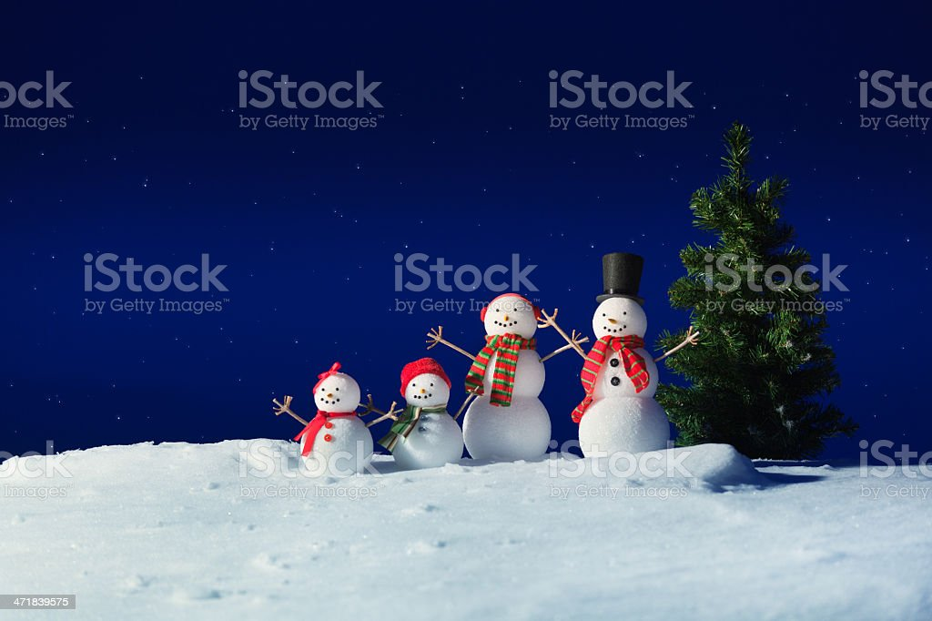 Snowman Family in the Winter Night royalty-free stock photo