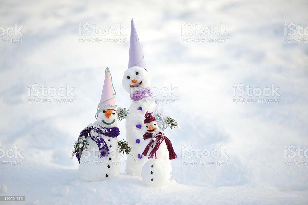 Snowman family members ready for celebrating christmas holidays royalty-free stock photo