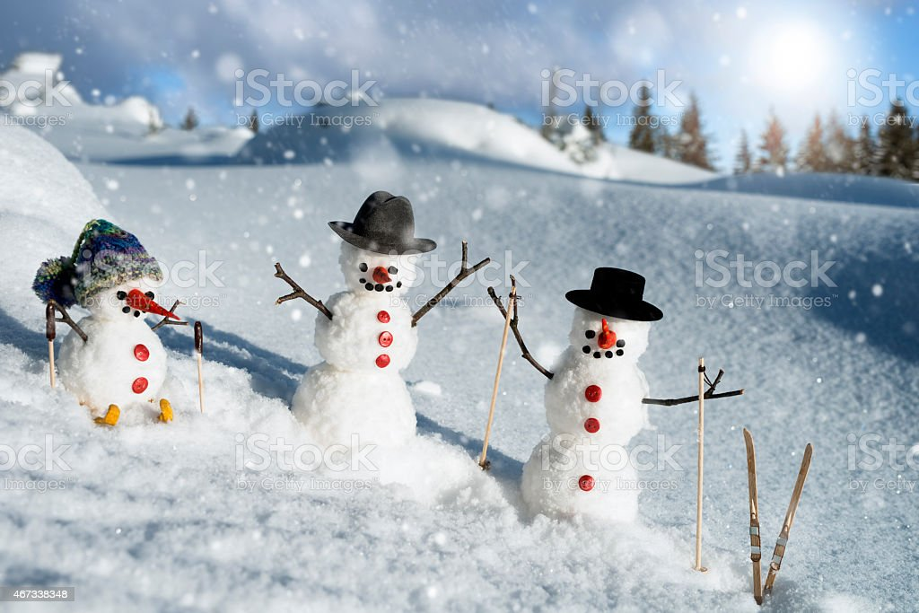 Snowman family team stock photo