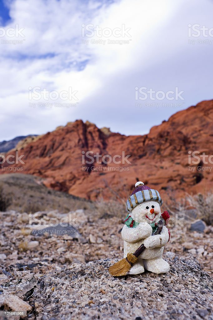 Snowman Figurine and Sandstone Hills stock photo