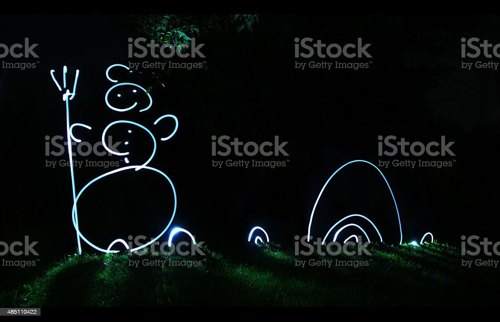 Snowman from light. Waiting for Christmas and New Year stock photo