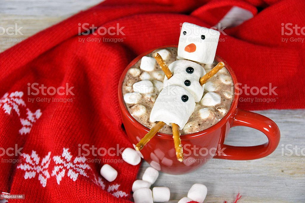 snowman in hot chocolate drink stock photo