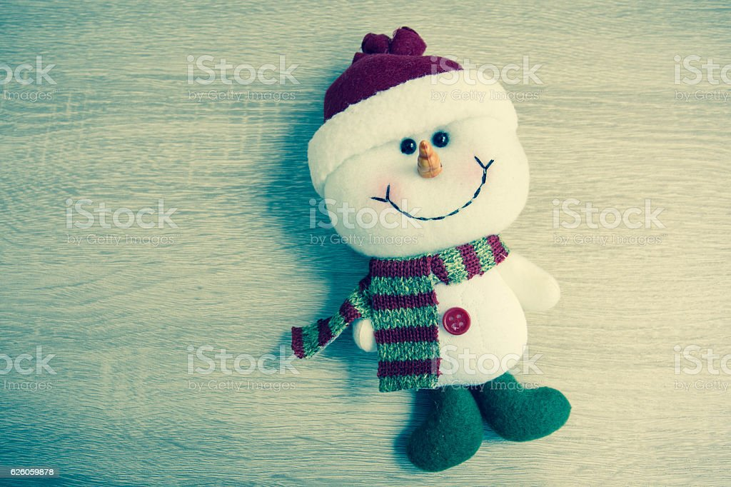 Snowman laying On wooden table. stock photo