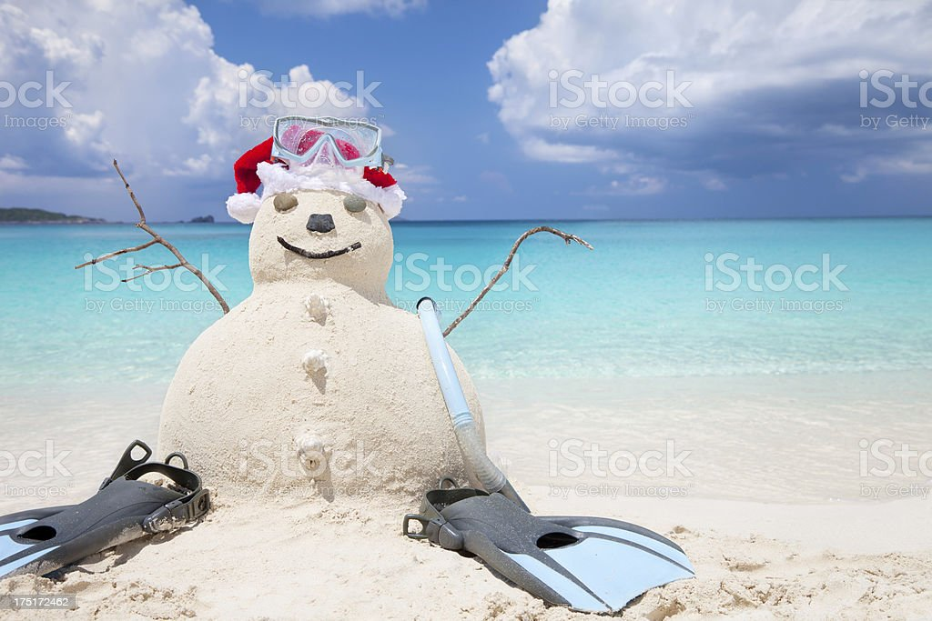 Snowman made of sand with snorkeling gear at a beach royalty-free stock photo