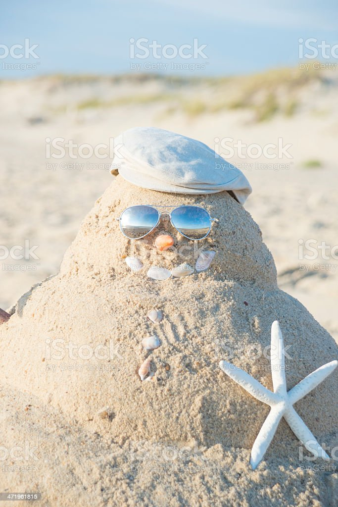Snowman Made Out Of Sand With Hat royalty-free stock photo